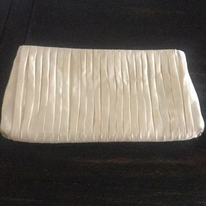 Off white rayon/silk clutch. Never used.